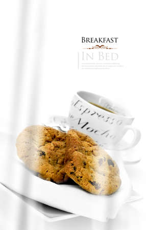 Dreamy oat and raisin cookies and coffee against a white bright background. Concept image for hotel room service or Mothers Day and Valentines Day. Generous accommodation for copy space.