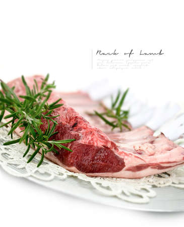 differential focus: Uncooked rack of lamb with rosemary herbs against a white background. Differential focus with generous accommodation for copy space.