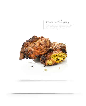 onion bhaji: Baked traditional Indian Onion Bhajis against a white background. Sharp focus with generous accommodation for copy space. The perfect image for your modern, high class menu cover art. Different.