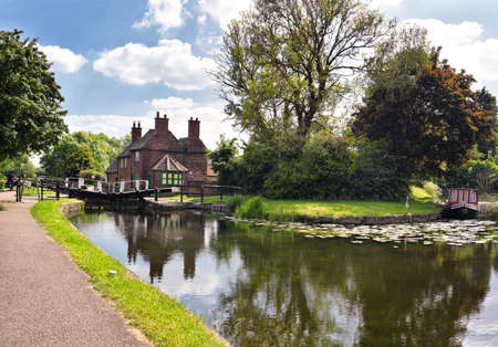 NOTTINGHAM, UK - May 25, 2017: Sandiacre Lock Cottage maintained by the Erewash Canal Preservation Development Association. United Kingdom.