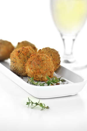 Italian appetizer Mushroom Arancini with mozzarella cheese filling coated in breadcrumbs with thyme herbs. Generous accommodation for copy space.