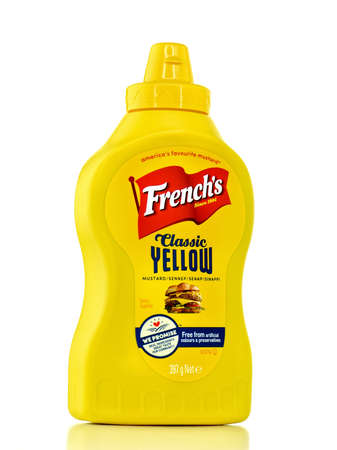 NOTTINGHAM, UNITED KINGDOM - AUGUST 11, 2017: A Squeeze Bottle of Frenchs Brand Classic Yellow Mustard on a bright background in an illustrative editorial image.