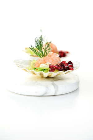 Fresh Tiger Prawn canapes with whipped cream cheese, dill and pomegranate garnish shot against a white background with generous accommodation for copy space. Stock Photo