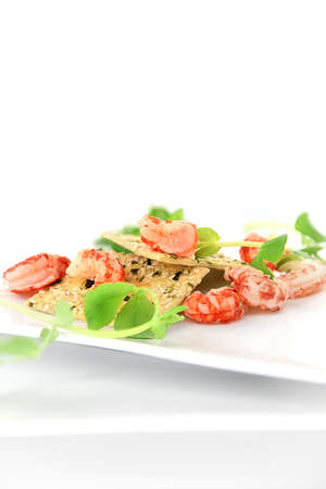 Freshwater crayfish tails with pumpkin seeded crackers and pea shoot garnish. Perfect image for your wedding reception cover art or your fresh summer dining concept designs.