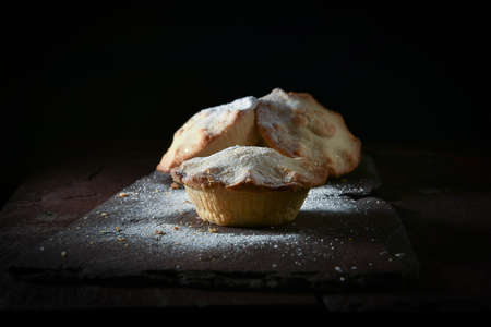 Selective focus on festive traditional mince pie shot against a dark  background with accommodation for copy space. The perfect image for your Thanksgiving and Christmas design art