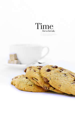 A stylish and modern twist on a classic stock image, fresh home-made cookies with a coffee cup in the background with accommodation for copy space. Time to take a break.