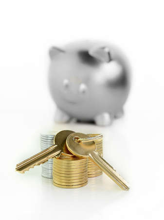A unique and original concept image of saving for a new home. Stacked coins and house keys in front of a gold piggy bank, symbolizing saving. Differential focus with copy space.