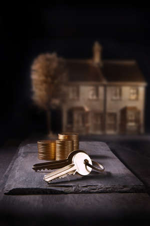 A unique and original concept image depicting home purchase and financial investments. Image shot with creative lighting with generous accommodation for copy space.
