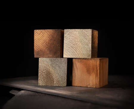 Creatively lit stacked cubes of wood left blank for your own design use with embossed or typed letters. Generous accommodation for copy space. Standard-Bild