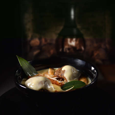 The ultimate home-made comfort food chicken soup, creamy chicken soup with roasted fillets of chicken breast, sage and onion stuffing ball dumplings served with a bay leaf garnish.
