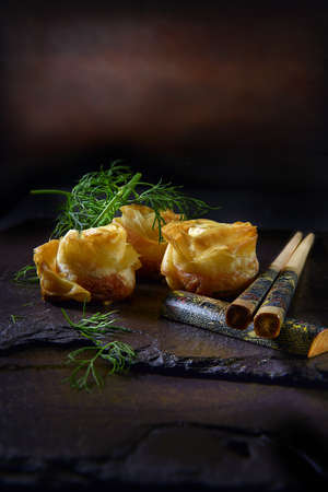 Traditional styled Chinese prawn roses with chilli and crispy filo pastry. Shot against a dark background with generous accommodation for copy space.
