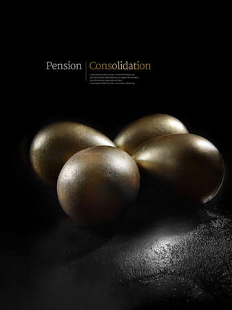 Concept image for pension investments, consolidatyion and savings. Gold painted eggs shot against a black background with generous copy space. Illustrative text can easily be removed.