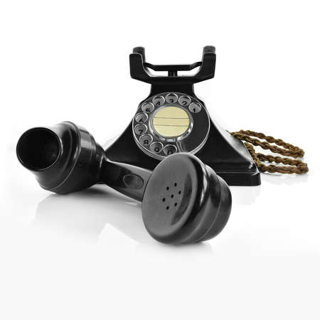 A genuine original British GPO telephone from the 1940's made from bakelite in black. Shot in high-resolution against a white background to allow addition of generous accommodation for copy space.