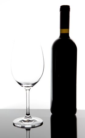 red wine glass and a wine bottle on table with white background Stock Photo - 7753163