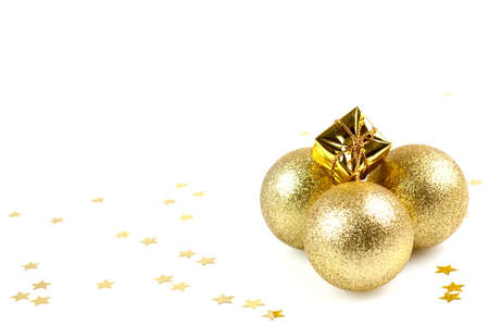 golden christmas balls and present with copy space isolated on white photo