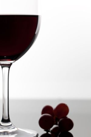 full red wine glass and grape Stock Photo - 7753206