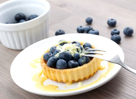 cake with bilberry on plate photo