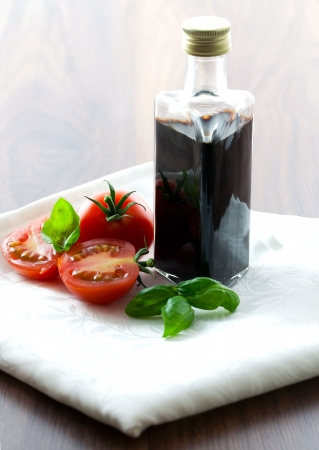 balsamic in bottle with tomato