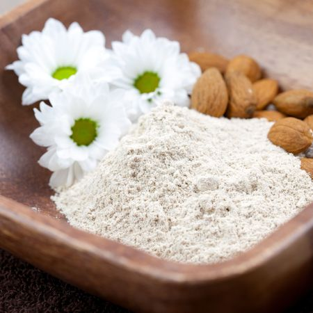 bran: fresh almond bran powder in bowl closeup Stock Photo