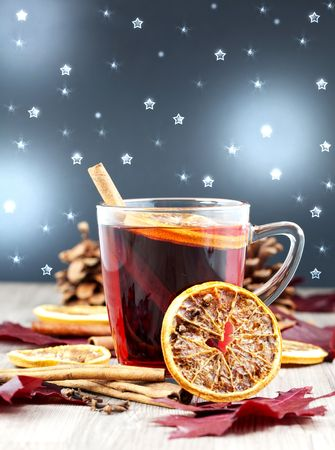a glass of glogg with decorated background photo
