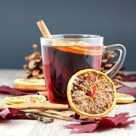 a glass of glogg decorated with cinnamon and orange photo
