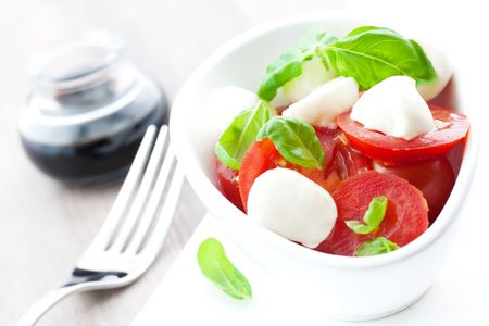 fresh caprese salad in bowl  Stock Photo
