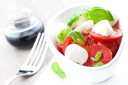 caprese: fresh caprese salad in bowl  Stock Photo