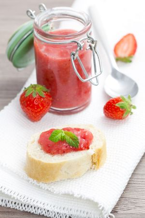 bread with fresh strawberry jam for breakfast  photo