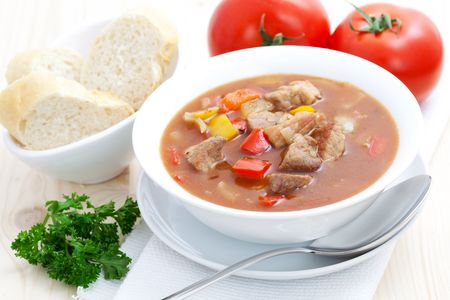 fresh goulash with baguette and paprika pepper  photo