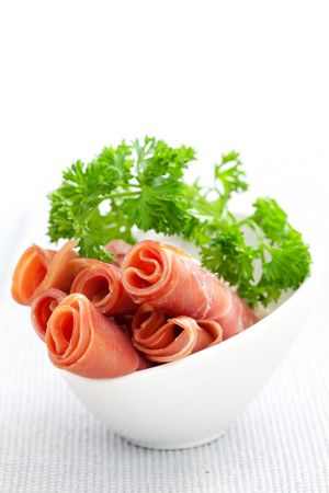 smoked sausage: fresh serrano ham with parsley  Stock Photo