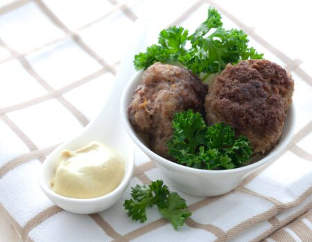 fried meat balls with mustard  photo