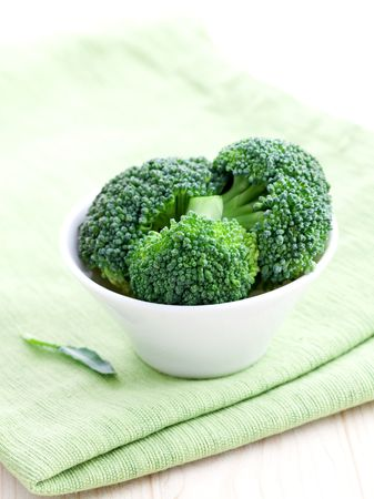 floret: fresh green broccoli floret in a white bowl  Stock Photo