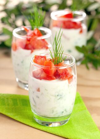 tzatziki: fresh tzatziki with tomato and dill  Stock Photo