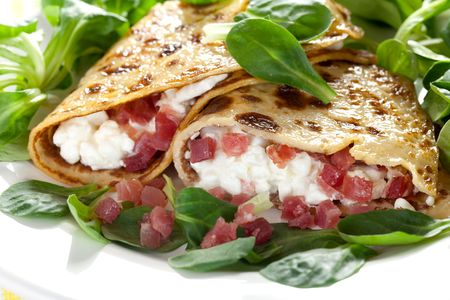 crepe: filled pancake with cottage cheese and ham  Stock Photo