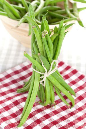 dishtowel: green beans bunch on dishtowel Stock Photo