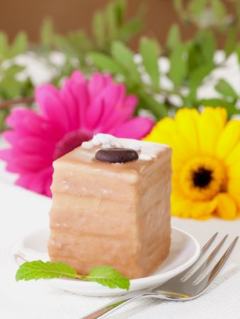 petit: petit four with chocolate and coffee cream  Stock Photo