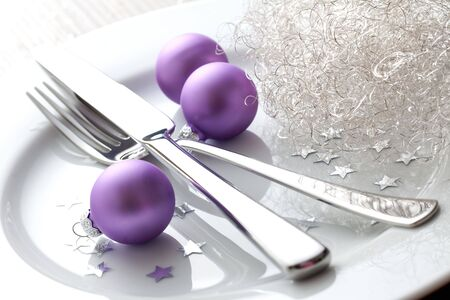 christmas place setting with christmas balls  photo