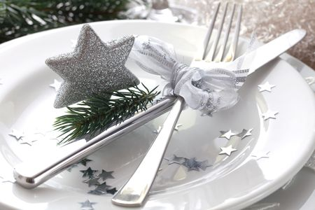 christmas place setting in silver with star   photo