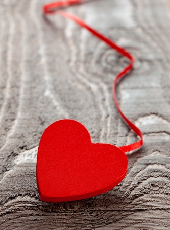 heart on ribbon on wooden table  photo