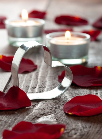 a heart with petals and candles  photo