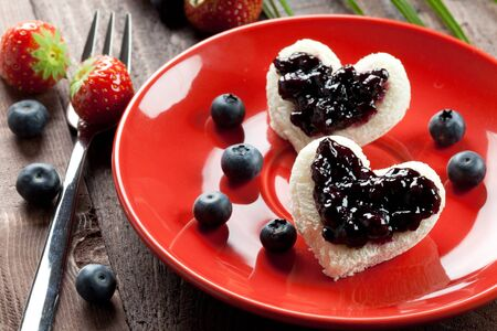 two toast hearts with fresh bilberry jam  photo