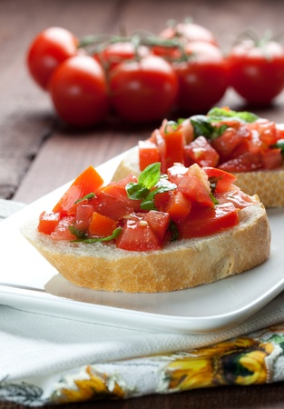 fresh bruschetta with tomato on plate  photo