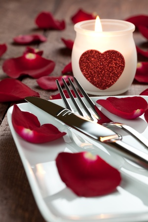 place setting with candle and cutlery  Stock Photo - 8467393