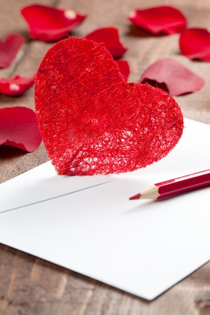 envelope with pen and heart  photo
