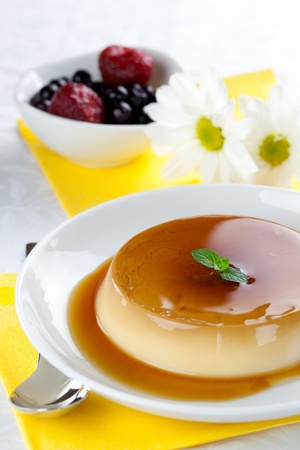 panna cotta with caramel on plate  photo