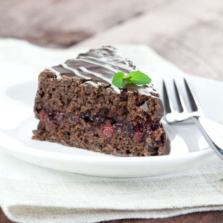 fresh chocolate cake on plate  photo