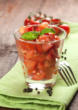 fresh tomato salad with basil in a glass  photo