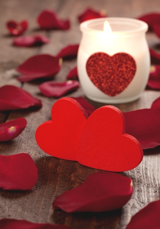 two red hearts and burning candle Stock Photo - 8467409