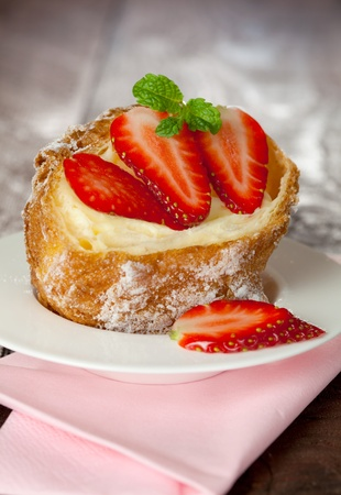 cream puff with pudding and strawberries  photo