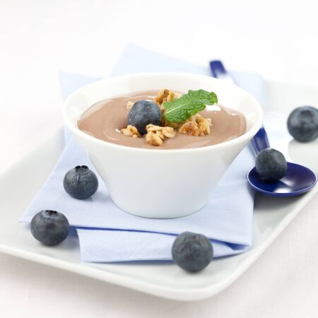 bilberries: creamy caramel pudding in bowl with bilberries